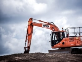Orange excavator in operation