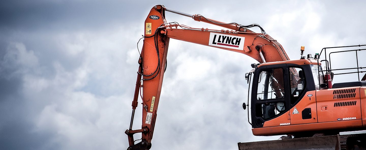 L Lynch orange excavator in operation