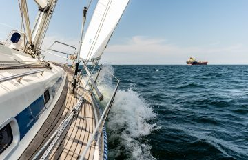 Boat sailing through choppy waters