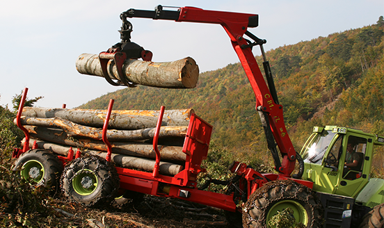Forestry truck lifting tree logs
