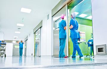 Health care workers in hospital corridor