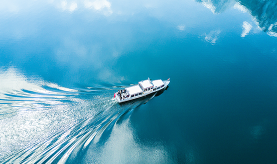 Boat sailing across blue water