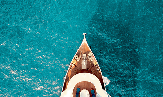 Front of boat sailing across blue waters