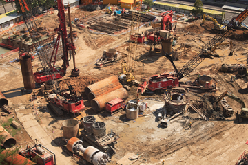 Civil construction site with cranes and building equipment