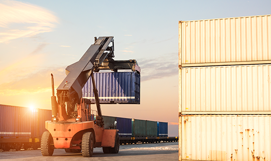 Forklift truck lifting a cargo container