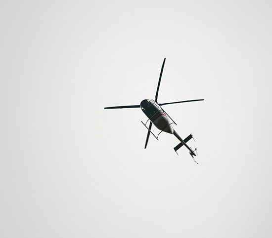 Bottom view of flying helicopter