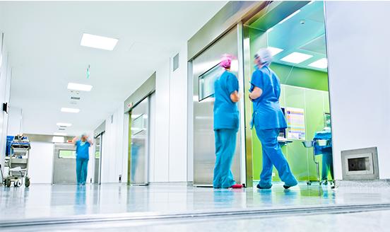 Nurses standing in hospital corridor