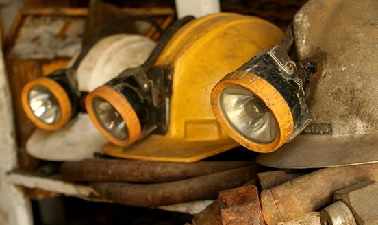 Mining hats and lights on a shelf