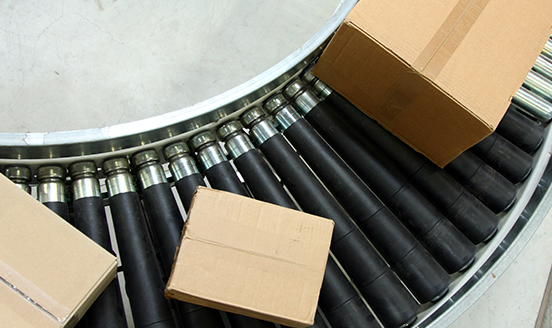 Boxes travelling on an assembly line