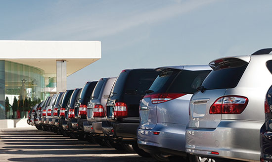 Fleet of cars parked side by side