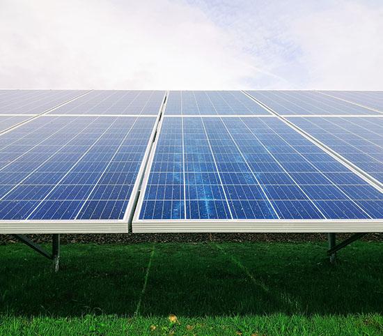 Solar panels on a grass field
