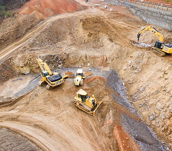 Heavy machinery operating in a quarry