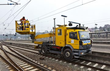 Hi rail truck on rail tracks