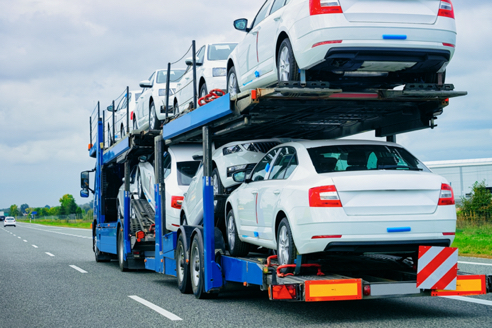 Car transporter carrying multiple vehicles